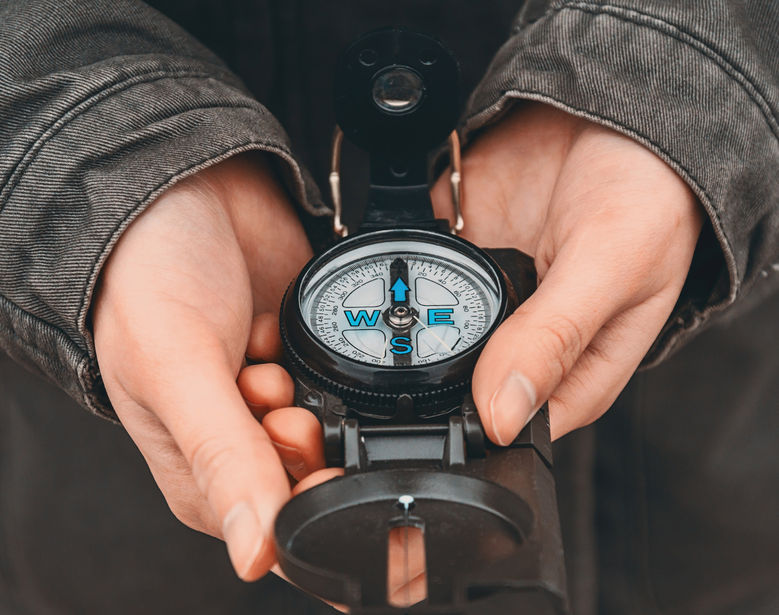 woman holding old compass