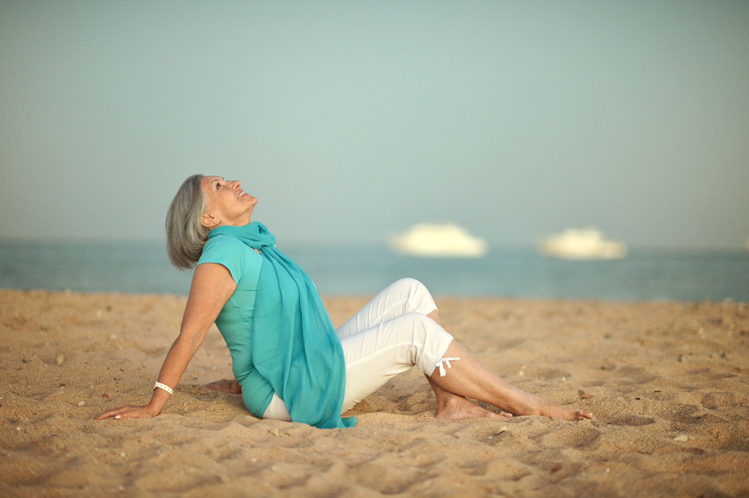 mature woman relaxing on beach