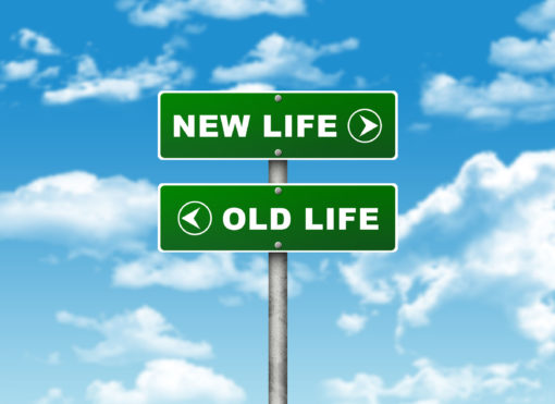 road sign pointing to new life and old life