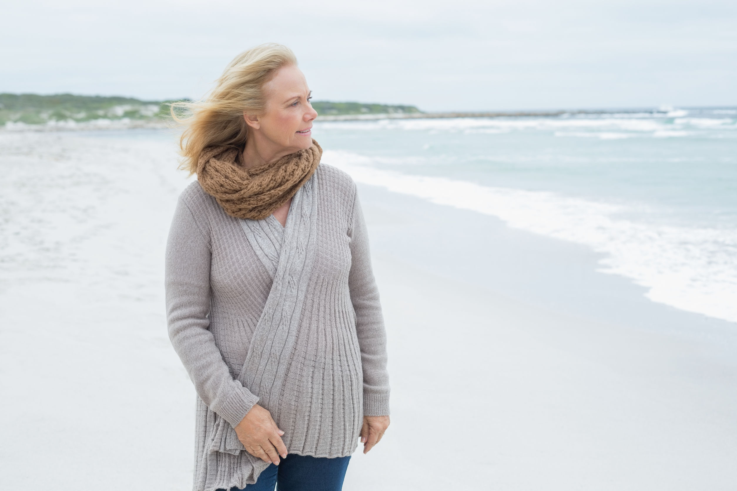 Contemplative senior woman at the ocean