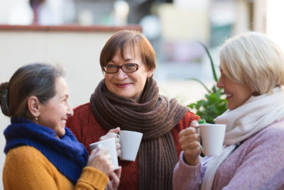 group of women talking over coffee