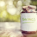 Savings money jar full of coins concept for saving or investment for a house, retirement or education, financial peace, finances