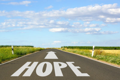 road in country with the word hope written on it